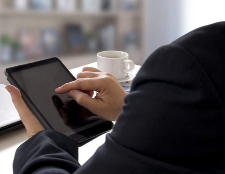 business man working and touch tablet on his hand in office