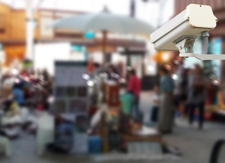 Closeup image of CCTV security camera at shopping center