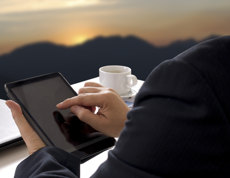 business man working and touch tablet on his hand Stock Photo