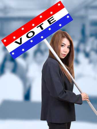 woman holding election banner campaign and calling people go to vote
