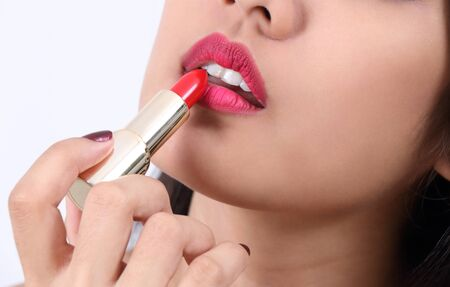 young beautiful asian woman applying makeup
