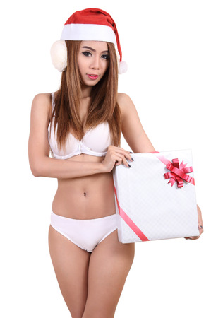 asian beautiful woman in white bikini and santa claus red hat for christmas Stock Photo