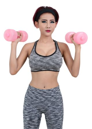 young asian woman in fitness clothes and holding dumbbell