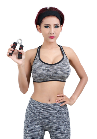 young asian woman in gray fitness clothes