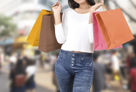 asian woman at shopping street with abstract blurred background Stock Photo