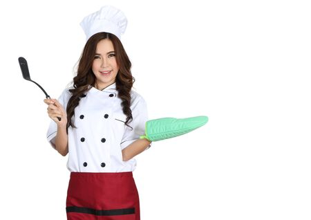 young woman chef in chef uniform with white hat  Stock Photo