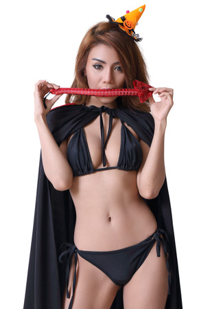young asian woman witch in black bikini on white background