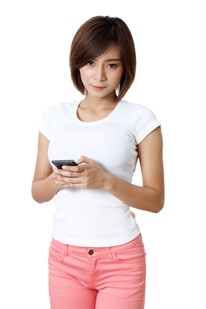 beautiful young asian woman holding smart phone on hand Stock Photo