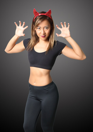 young asian woman witch in black clothes on black background Stock Photo
