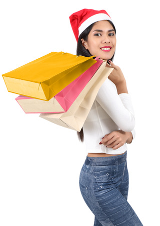 beautiful asian woman with red hat holding shopping bag for christmas