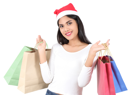 beautiful asian woman with red hat holding shopping bag for christmas Stock Photo - 91696200
