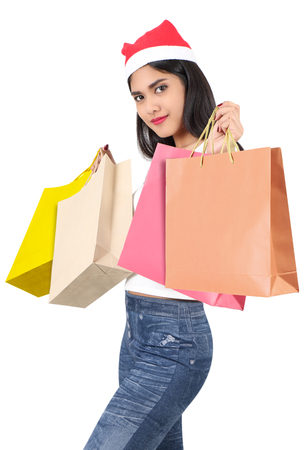 beautiful asian woman with red hat holding shopping bag for christmas Stock Photo - 91257650