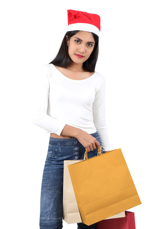 beautiful asian woman with red hat holding shopping bag for christmas Stock Photo - 91601107