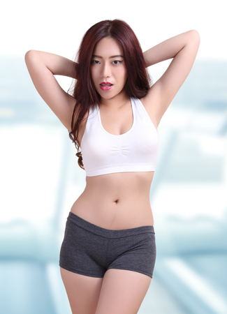 beautiful asian woman wearing fitness clothes in fitness center