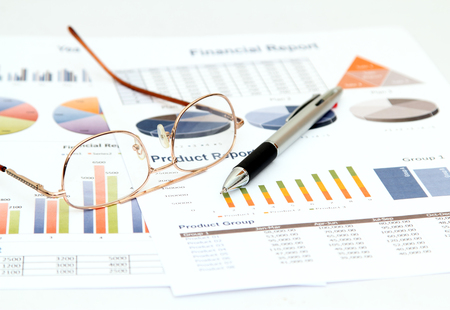 Image of business and report with graph and chart on white paper Stock Photo - 98922575