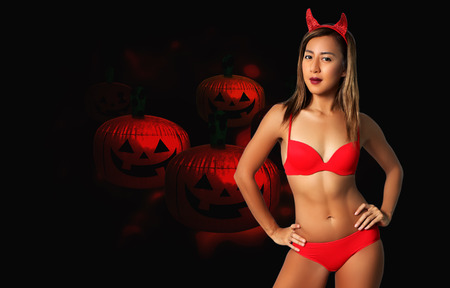 sexy devil woman in red bikini and halloween Stock Photo
