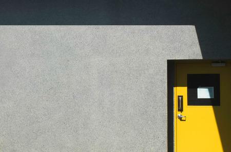 Yellow door in factory photo