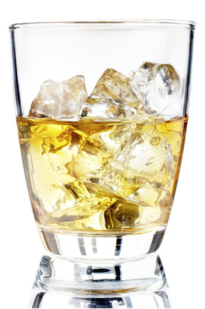Glass of scotch whiskey and ice on a white background photo