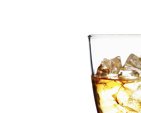 scotch: Glass of scotch whiskey and ice on a white background Stock Photo