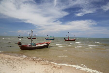 Small fishing boats in the sea. photo