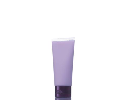 Purple plastic tubes isolated on white background. Stock Photo