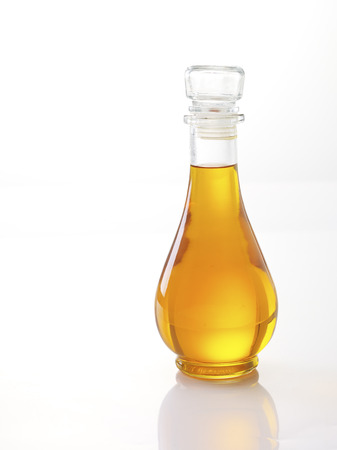 glass containers: Vegetable oil bottle isolated on white background