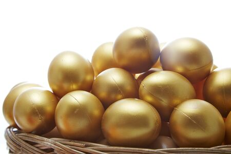 retiring: golden eggs in a basket on white background