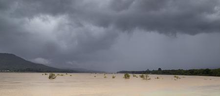 dark clouds: Mekong river under dark clouds Stock Photo