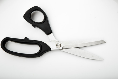 snip: Black shears on a white background. Stock Photo