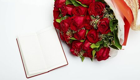 blank note: A bouquet of red roses with notes