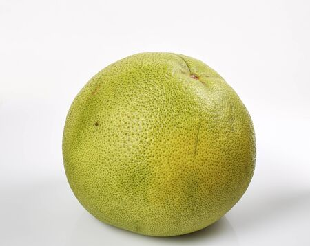 pummelo: Green pomelo citrus fruit with cut isolated on White. stack