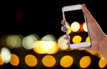 car sales: using smartphone, car sales Stock Photo