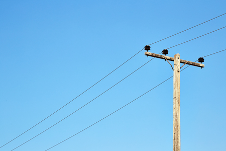 voltage gray: lamp post ; isolated object on blue  background ; electricity industry Stock Photo