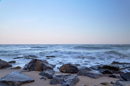 breakwater: sunset and beach, Stone breakwater Stock Photo
