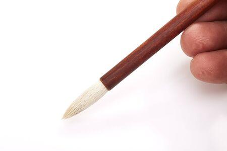 brush in: writing brush in mans hand