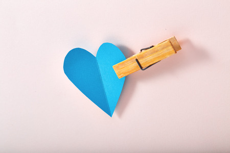 paper heart: Blue paper heart on pink paper, background