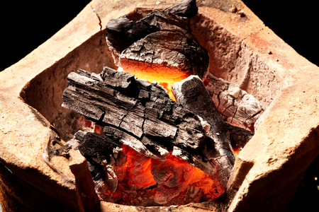 tradition: burning charcoal in old stove, thailand tradition