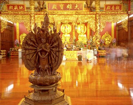 enlightenment: Golden buddha statue in Chinese temple, Mercy Temple enlightenment, Kanchanaburi
