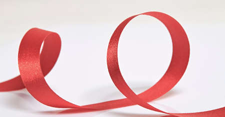 paths: Red ribbon on a white background with clipping paths