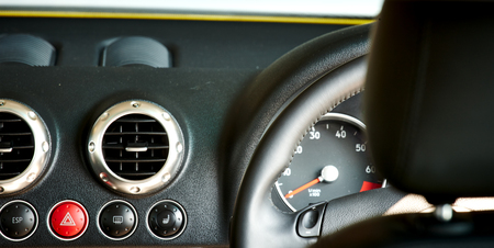 brushed aluminium: luxury car black leather and brushed aluminium interior inside view with automatic transmission