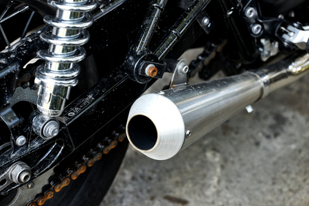 chromed: Big chromed exhaust on motorcycle