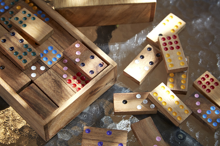 gambling stone: Wood domino game on glass table, daylight Stock Photo