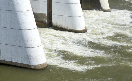voltage gray: Mae Klong Dam stops the water flow of Mae Klong River, Tha Moung, Kanchanburi, Thailand Stock Photo