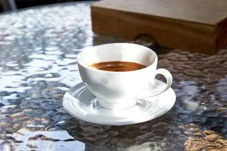 winnower: cup of coffee on  glass table