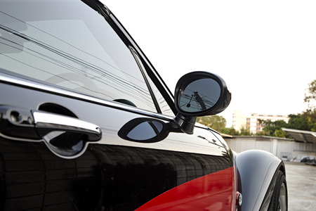 car side: Angle shot of a car with reflection, car side mirror