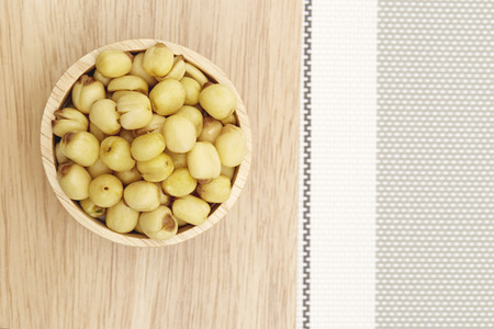 lotus seeds: Dried lotus seeds on wooden background  Dried lotus seeds Stock Photo
