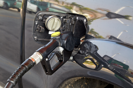 refilling: Image of refilling the car with diesel fuel on a gas station