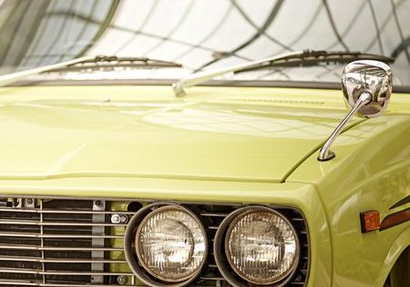 yellow car: Headlight lamp vintage yellow car.
