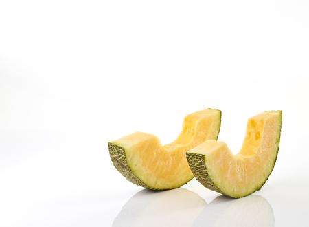gastritis: Hamigua Melon cut into slices, Hami Melon, Hami Cantaloupe isolated on white background. stack imag