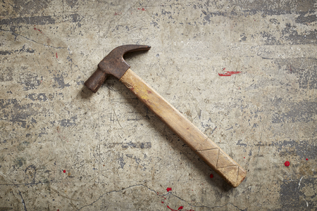 housebuilding: Hammer isolated on concrete background texture